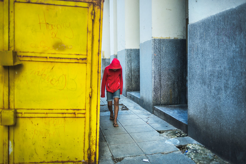 Kid with red hood in the streets