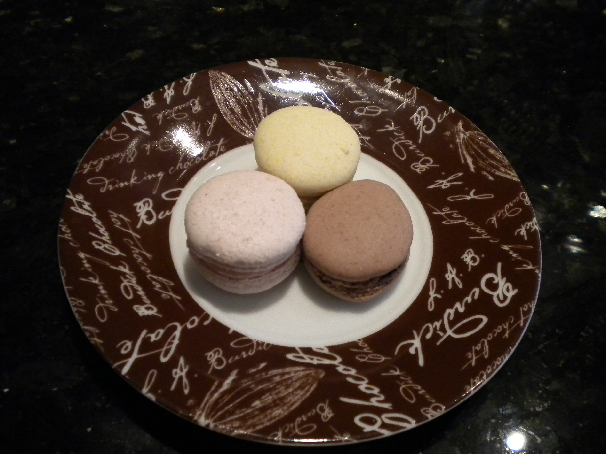 Raspberry, Ginger, and Chocolate macarons. Tiny things aren't they?