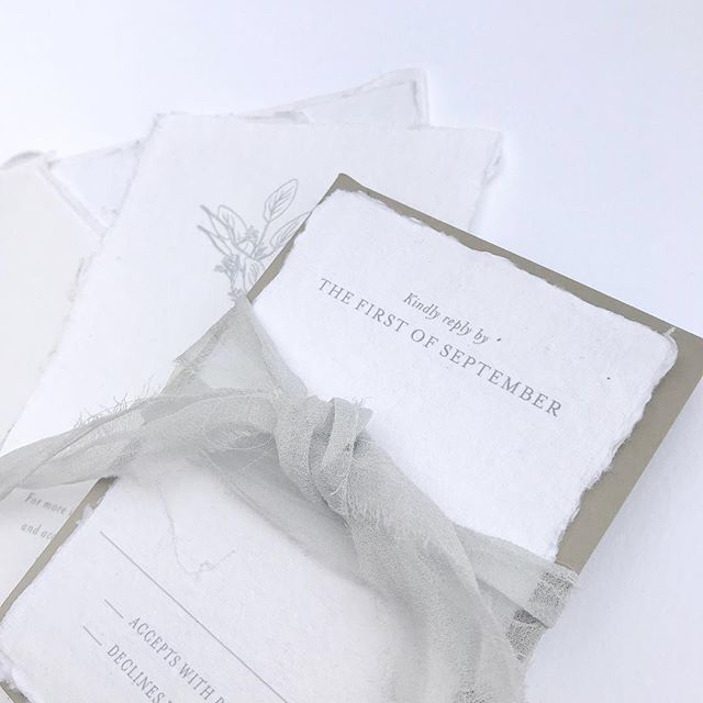 There are so many ways to pair a subtly elegant invitation with colored envelopes & ribbon...loving this grey pairing too!