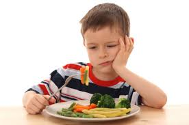 kid doesn't want to eat his vegetables