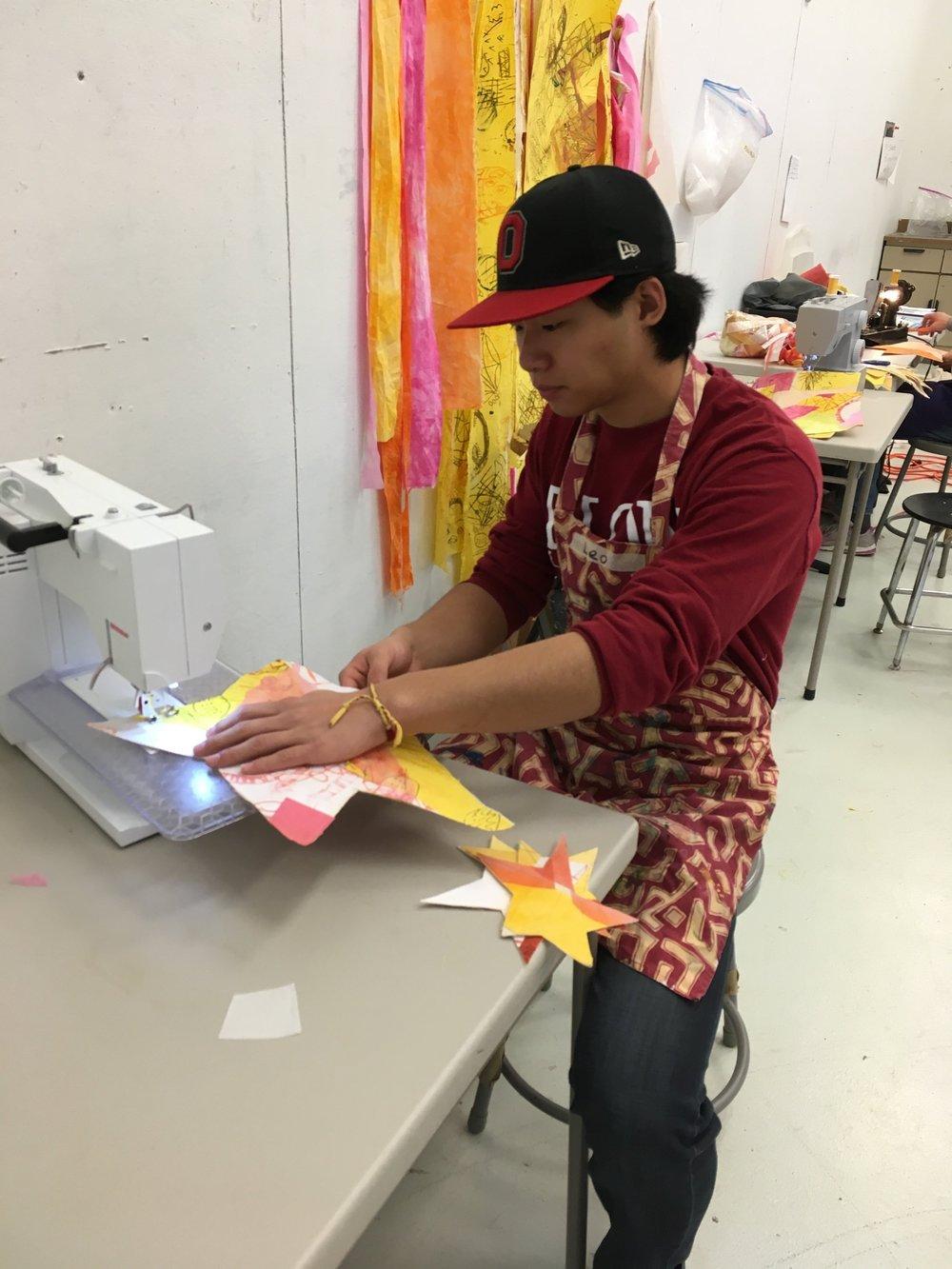 Leo sewing.jpg