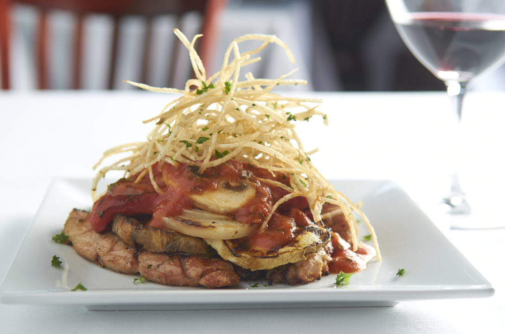 Mollejas De La Plata.  Grilled Veal Sweetbreads, Grilled Eggplant, Roasted Red Bell and White Onions, in Roma Tomato with Crispy Potato Shavings.