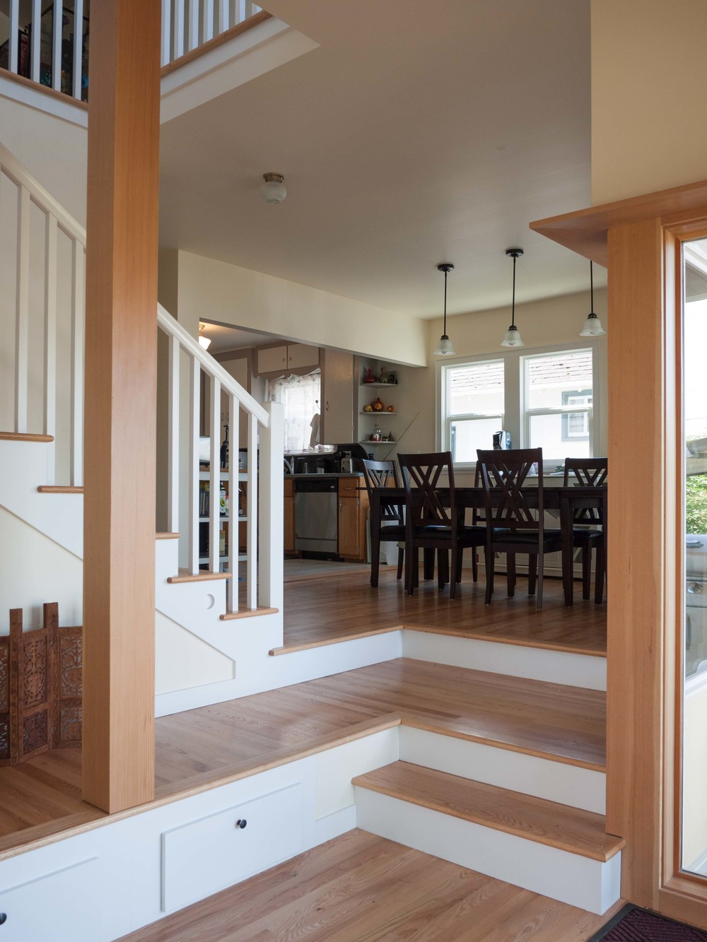 Beyond the mudroom is the dining room and existing kitchen.