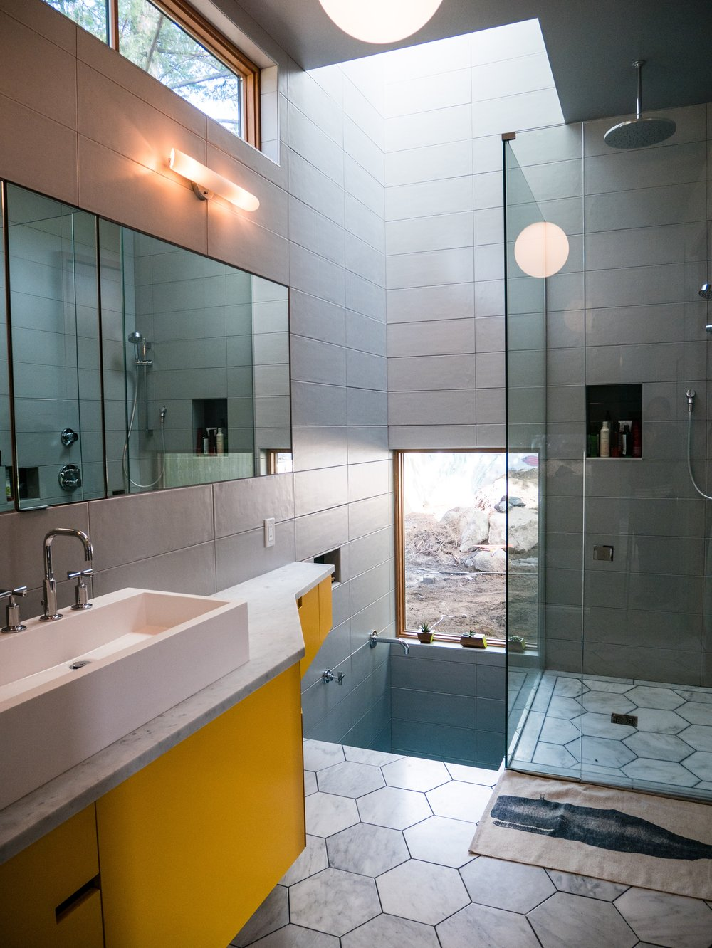 The bathroom includes a Japanese soaking tub, shower, partitioned toilet and plenty of natural light.