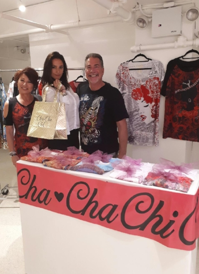 Model and Influencer, @alyshagrace (middle), shows off her bag of goodies while posing in-between the power couple behind Cha-cha Chic, Cathy Garcia (left) and   Jim Tiberia (right)