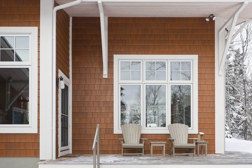White trim work contrasts with Nichiha fiber cement siding.