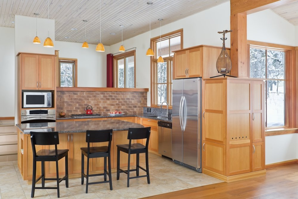 Efficient fir kitchen within a larger living space.