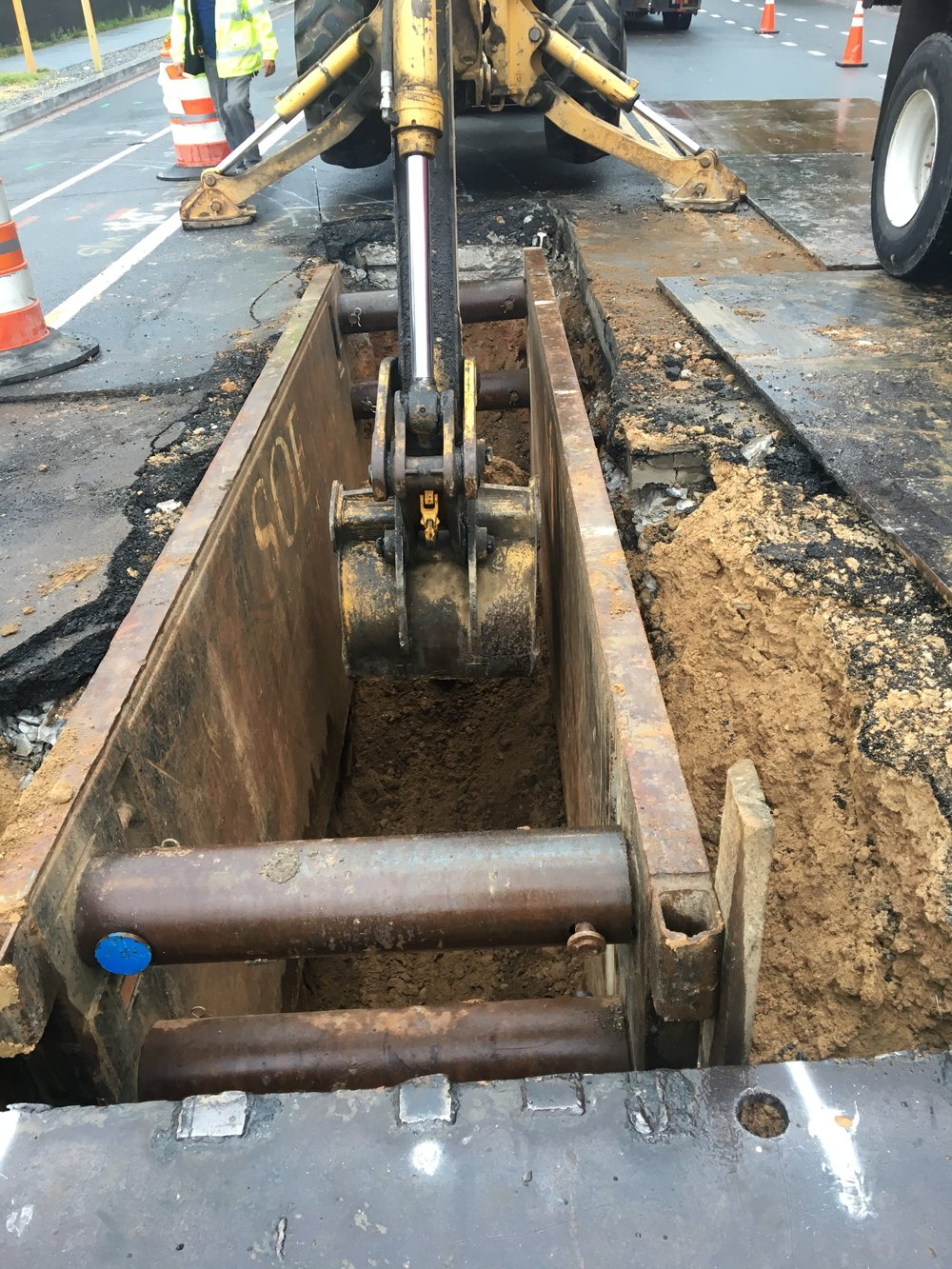 Trenching for fiberglass pipes at the intersection of 9th & Monroe