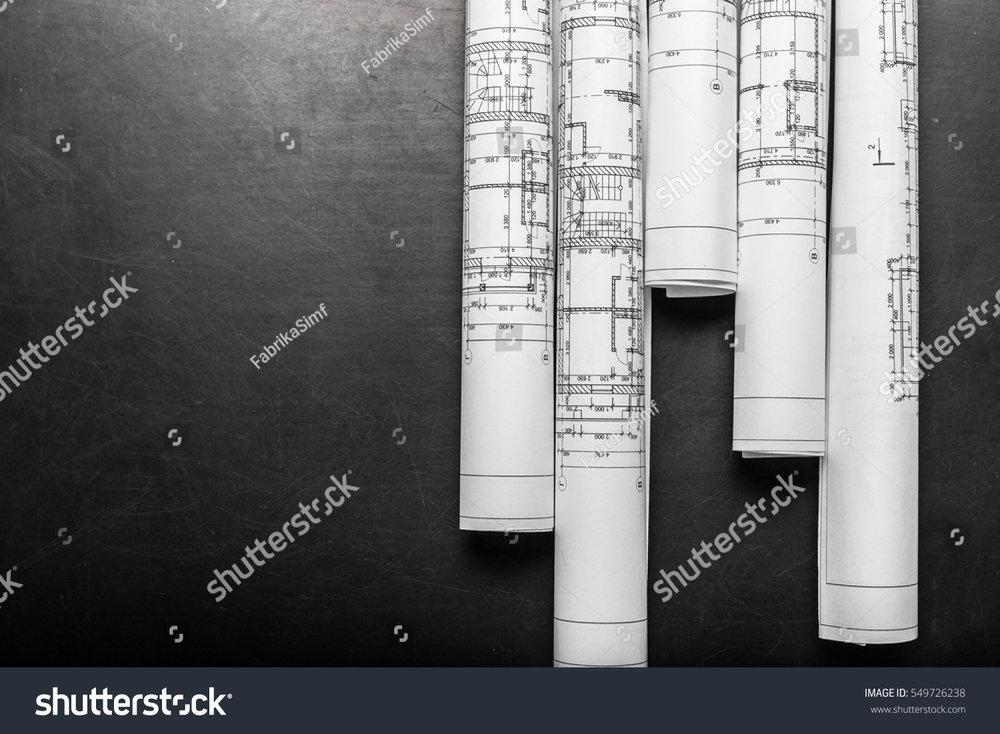 planning-drawings-on-black-background-549726238.jpg