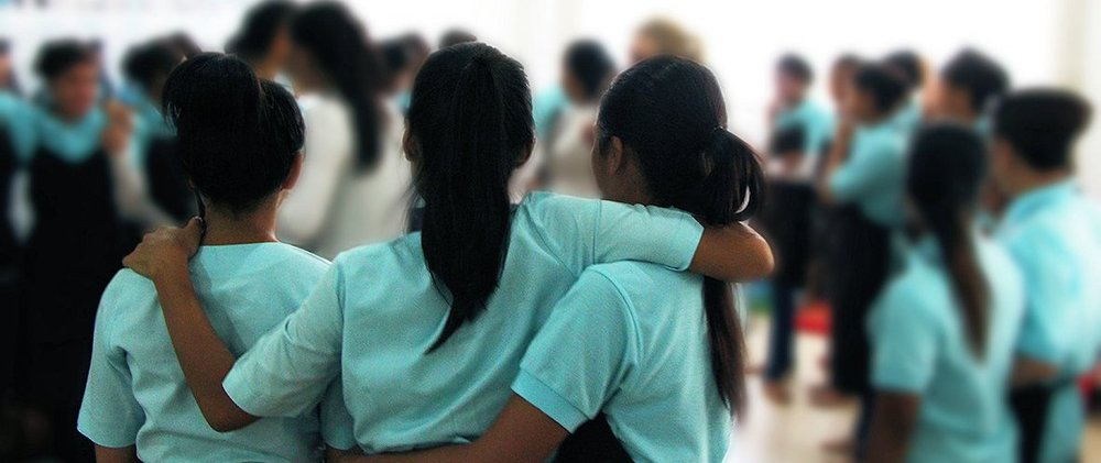 three girls hugging.jpg