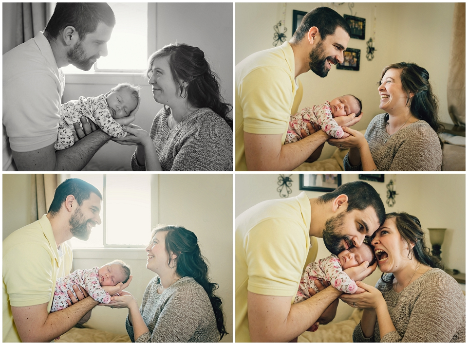 mom-and-dad-holding-newborn-lifestyle-photography-session-skagit.jpg