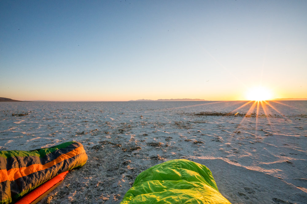 After waking up twice to take some long exposure shots like the one above, I tried to catch a few short hours of sleep.  Here is a photo of the sun rising over the horizon as we laid in our sleeping bags (and Russ still snored).