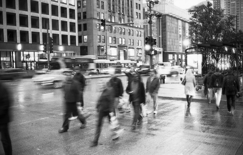Here's an image I shot handheld on film with a slow shutter speed, to make the people walking blur.