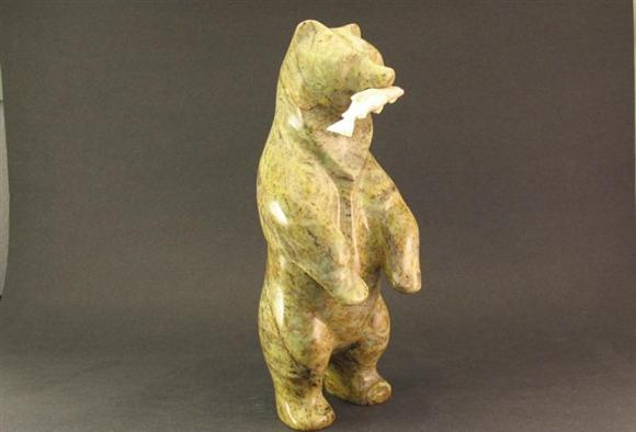 BEAR STANDING WITH FISH