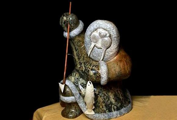 INUIT SHAMAN WALRUS TRANSFORMATION HUNTER WITH FISH KNEELING