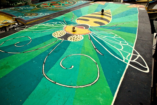 Bee mural by Maxine Nienow    In 2012, Maxine co-created  FlutuArte , a public art installation where 45 international artists joined to paint murals on the rooftops of 60 fishing boats in a historic harbor in Rio de Janeiro, Brazil. FlutuArte brought not only new vibrant colors to this fishing community, but also a new economy of tourism.