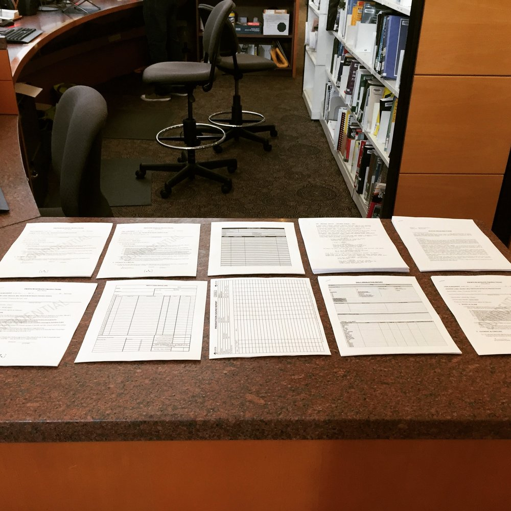 Contracts, callsheets, daily reports, shooting scripts and actor release forms. In short, a lot of paper.