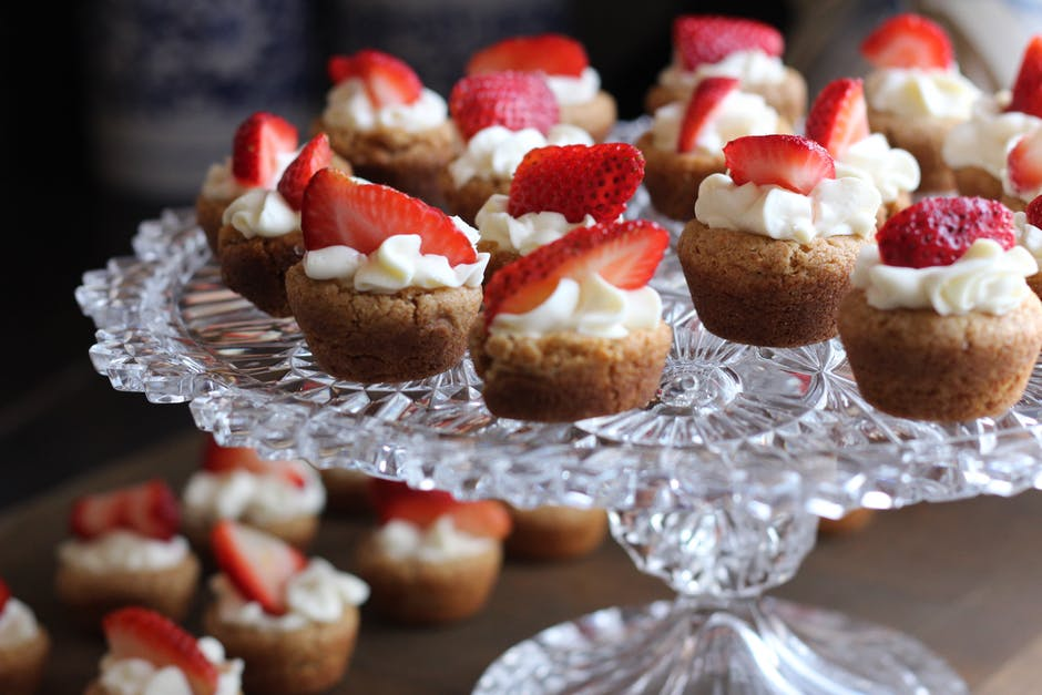 Homemade desserts like brownies and banana bread bites and add rustic charm to the sweets table.