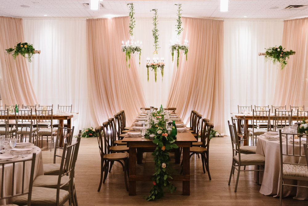 The  St. Marys Ballroom , styled with harvest tables, vineyard chairs and loose greenery for the rustic chic  Staffen wedding .   Decor & Styling:  Above & Beyond Event Design . Floral Design:  Lyric Flowers . Photography:  Erin Leydon .