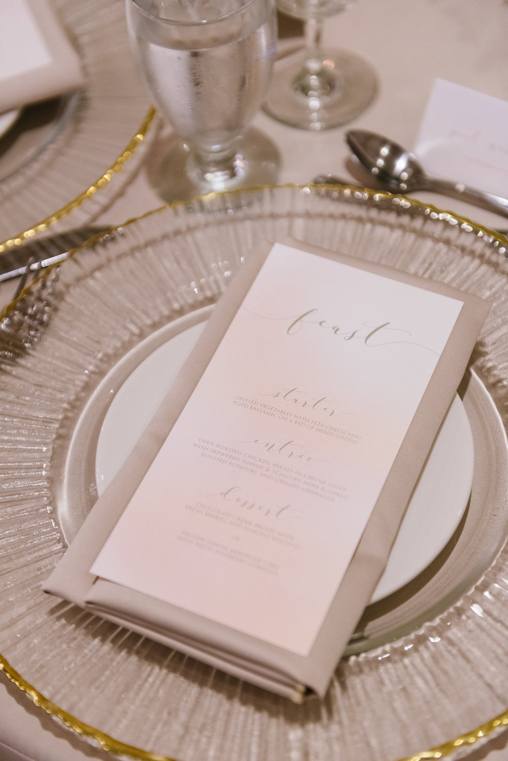 Calligraphy menu cards printed on a soft watercolour background, and placed on glass metallic-trimmed charger plates, mixes the refined with the undone. Venue:    St. Marys Golf & Country Club   .