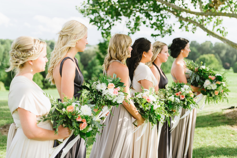 Floral and greenery bridesmaid bouquets by  Lyric Flowers . Photography:  Erin Leydon . Venue:  St. Marys Golf & Country Club .