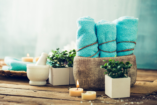 Stock baskets with luxurious spa items like towels, robes and slippers for decorative appeal, and for the comfort of your guests.