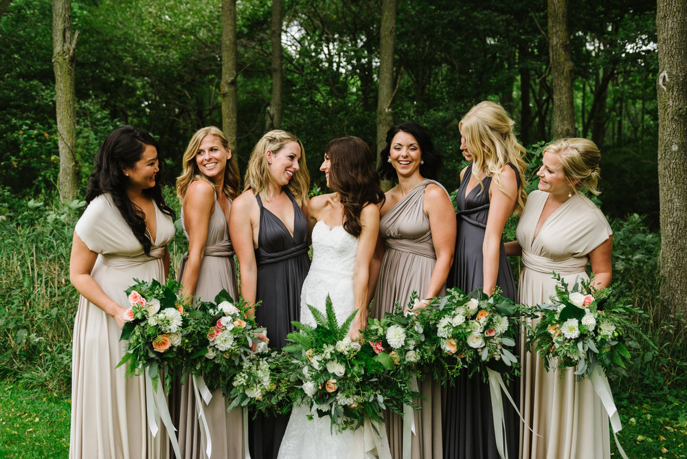 bridesmaids-ballgown-champagne-greenery-bouquets