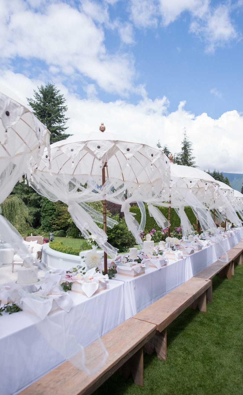 garden-party-white-umbrellas-wood-benches.jpg