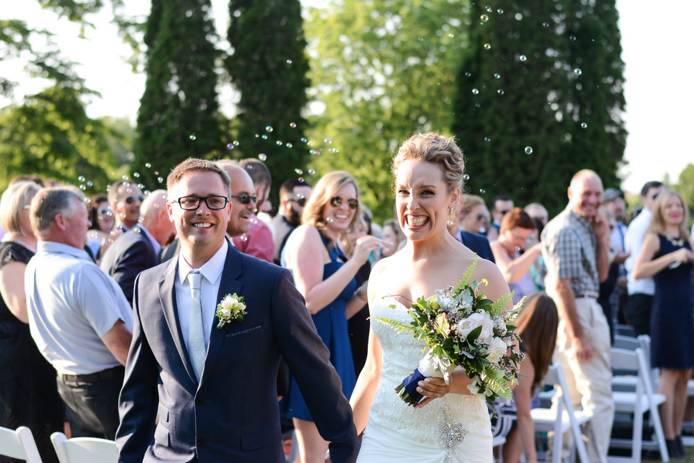 The newlyweds recessing after their ceremony is one of the happiest moments of their life, and a must have photograph for any couple's wedding album. Photography:  Nina Polidoro .