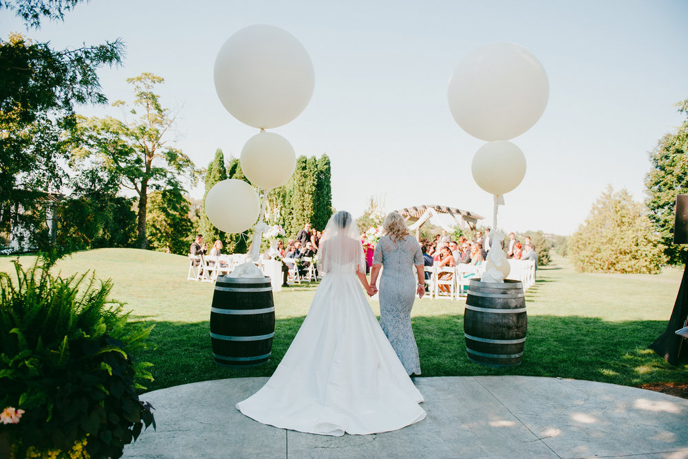 Sweeping shots of the ceremony setting during the bride's entrance are frame-worthy photos. Photography:  Bassem .