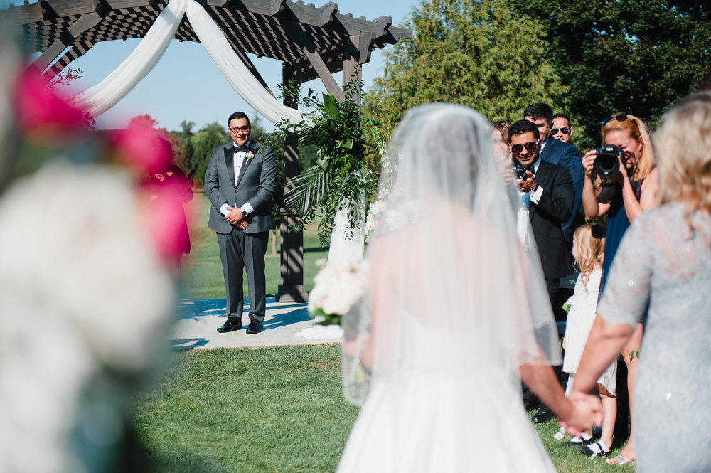 The groom's expression at the first sight of his bride is a priceless moment to capture on film. Photography:  Bassem .