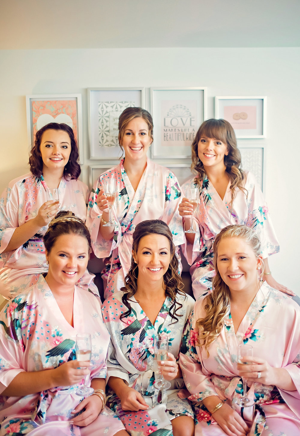 Champagne toasts and matching floral bridesmaid robes are essential for wedding day prep photos. See more from  Alicia & Sean's wedding . Photography: Melissa Avey.