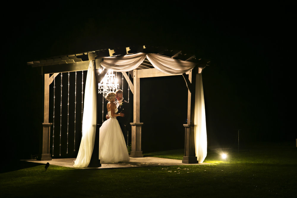 There is nothing more magical than a night snot of the newlyweds, accented by up-lighting and a romantic crystal chandelier. Photography:  Nancy French .