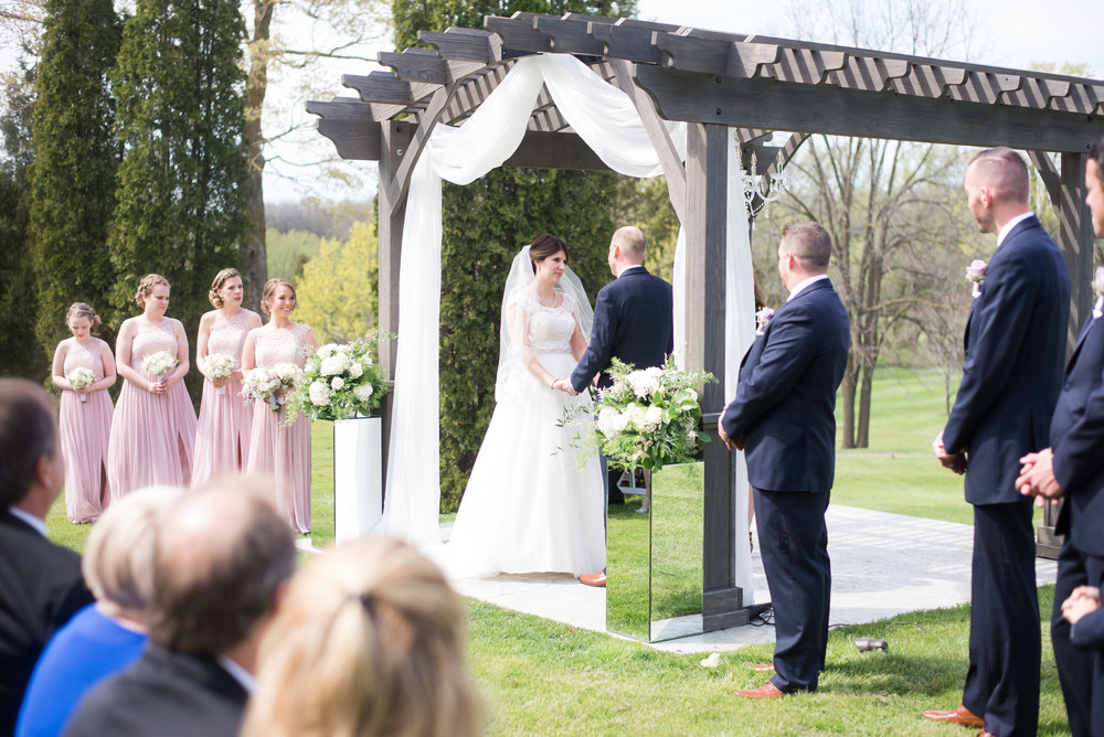 outdoor-ceremony-pergola-drapery-greenery