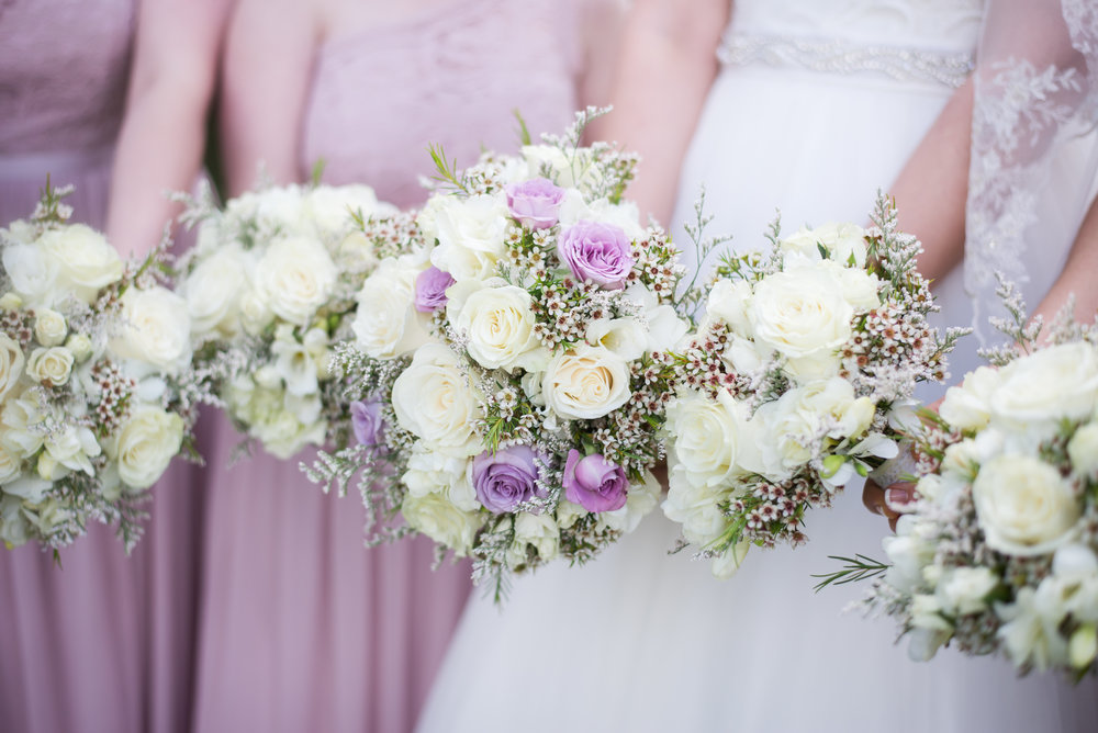 bridal-bridesmaid-bouquets-lavendar-white-roses-greenery