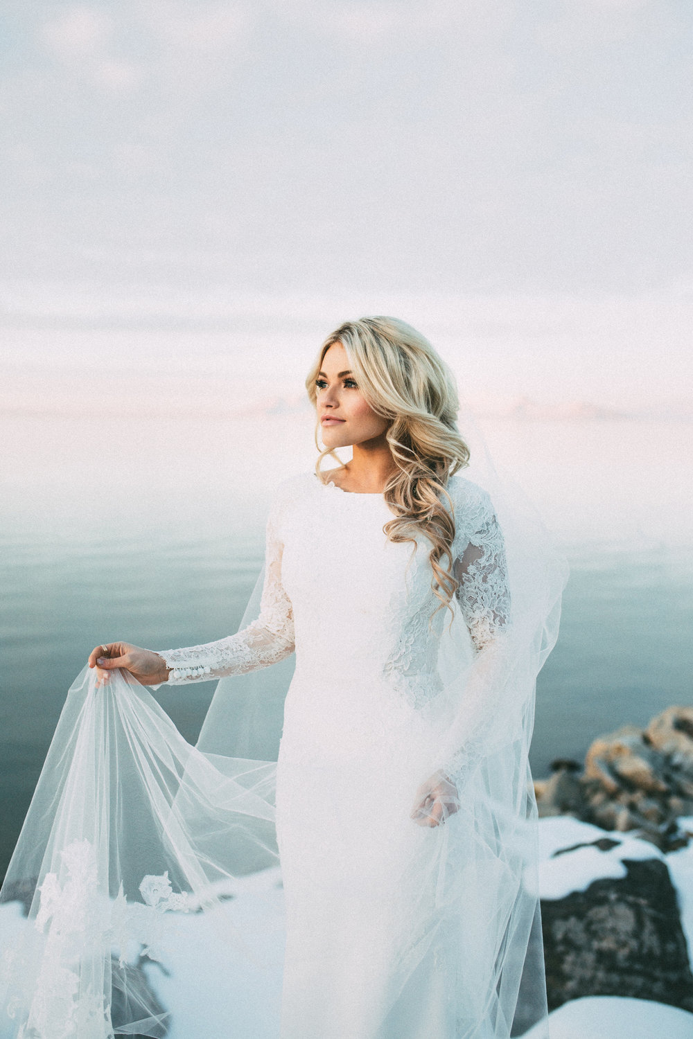 Long-sleeved lace wedding dresses will forever be a glamorous and timeless style for the winter bride. Photo Source:  India Earl Photography .