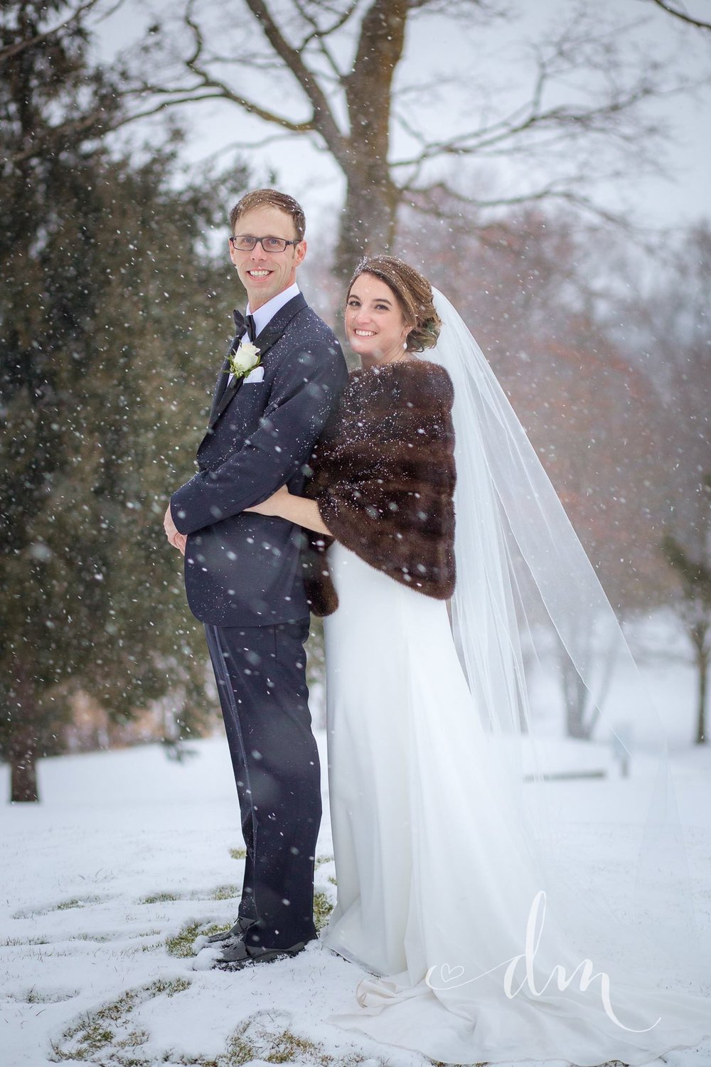 It doesn't get more picturesque than snowflakes freshly falling into portraits of the bride and groom. Venue:  St. Marys Golf & Country Club . Photography:  Danielle Mahoney Photography .
