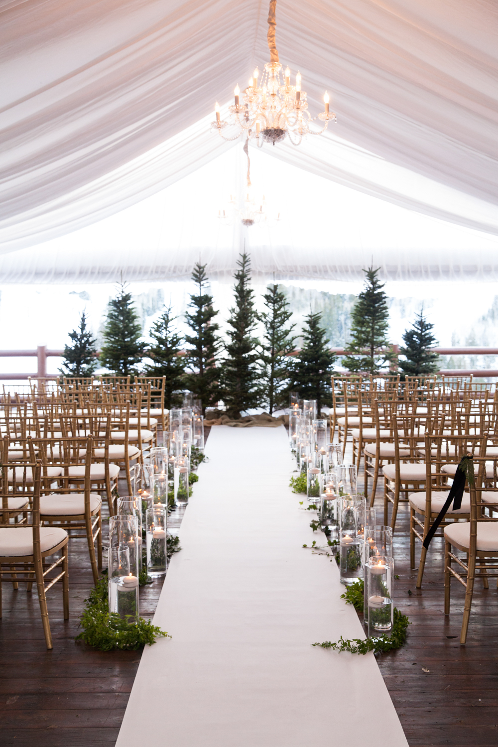 Give your guests the true winter wonderland wedding experience by exchanging your vows outdoors, surrounded by snow-covered trees and lots of sparkling candlelight. Photo Source:  Melissa Kelsey Photography .
