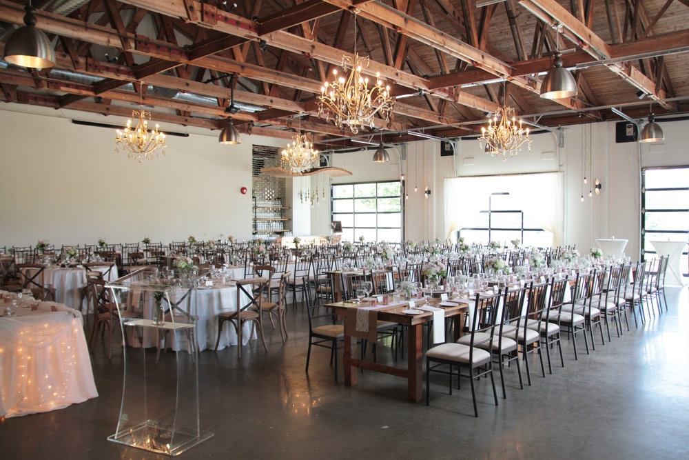 With an exposed wood beam ceiling, glass garage doors, and polished concrete floors, the  Hideaway  at St. Marys Golf & Country Club is an eclectic space that encompasses both a rustic and industrial feel.