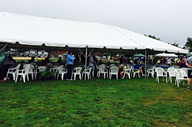 "White Frame Tent, Stackable Chairs and 60"" Round Tables"
