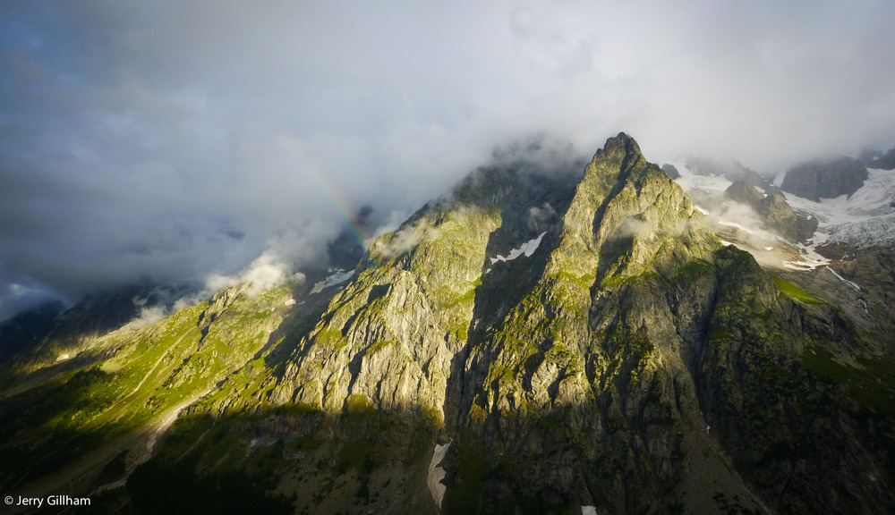 A promising start with a partial rainbow on the Grande Jorasses, the view from the refuge.