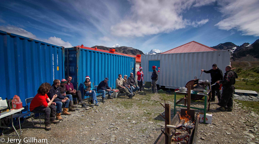 We returned in time for the builders' barbecue - a fabulous affair that went on all afternoon. The blue containers were dropped in to give shelter from the wind while the white container is a permanent fixture as it contains our sauna.