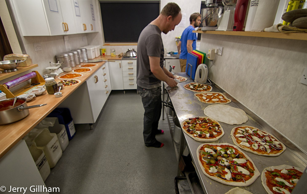 Dave putting the finishing touches to his pizza, while the queue builds up.