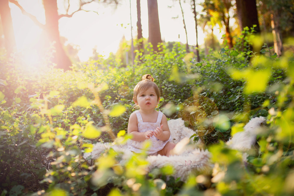 She reminds me o f my first doll baby- the cabbage patch in this image!  The cheeks the lips the big eyes and the greenery surrounding her!  Eeek!