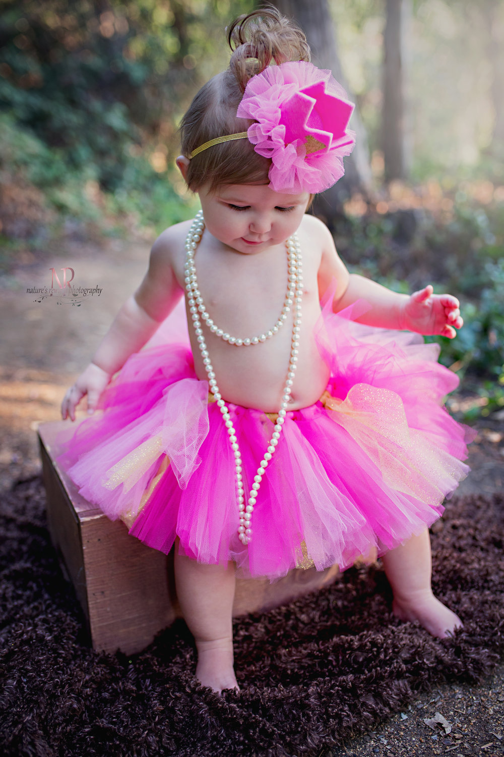 Pretty in her pink tutu and pearls