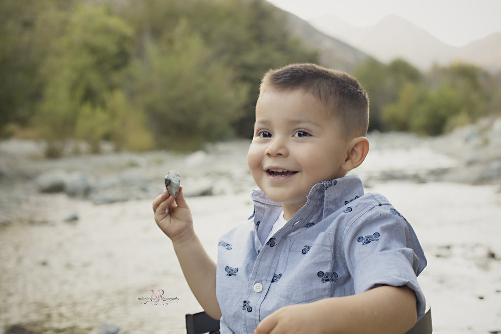 Throwing Rocks made him happy! Just like all little boys- some mischie f brings fun!