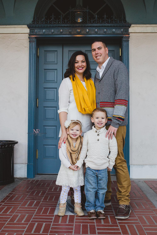 family image in front of blue door