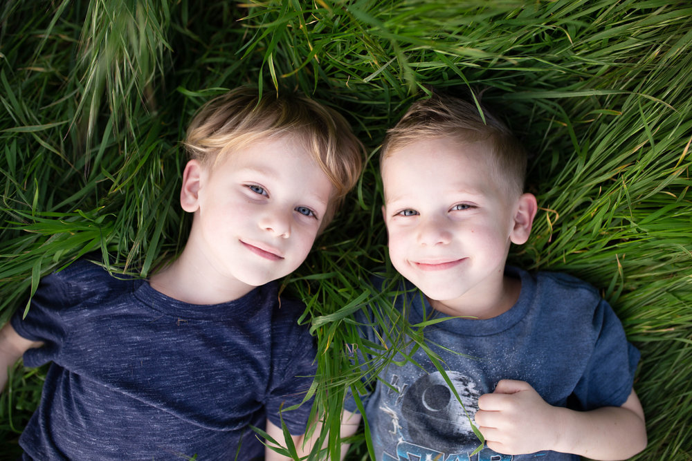 My identical twin boys- Caden left and Corben right.  I secretly hated it when they wanted different haircuts.  However, the ease of telling them apart now makes me look like a rockstar mom.