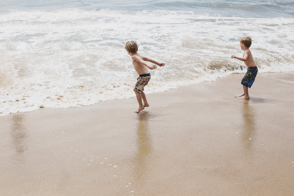 The Twins Playing in the Waves