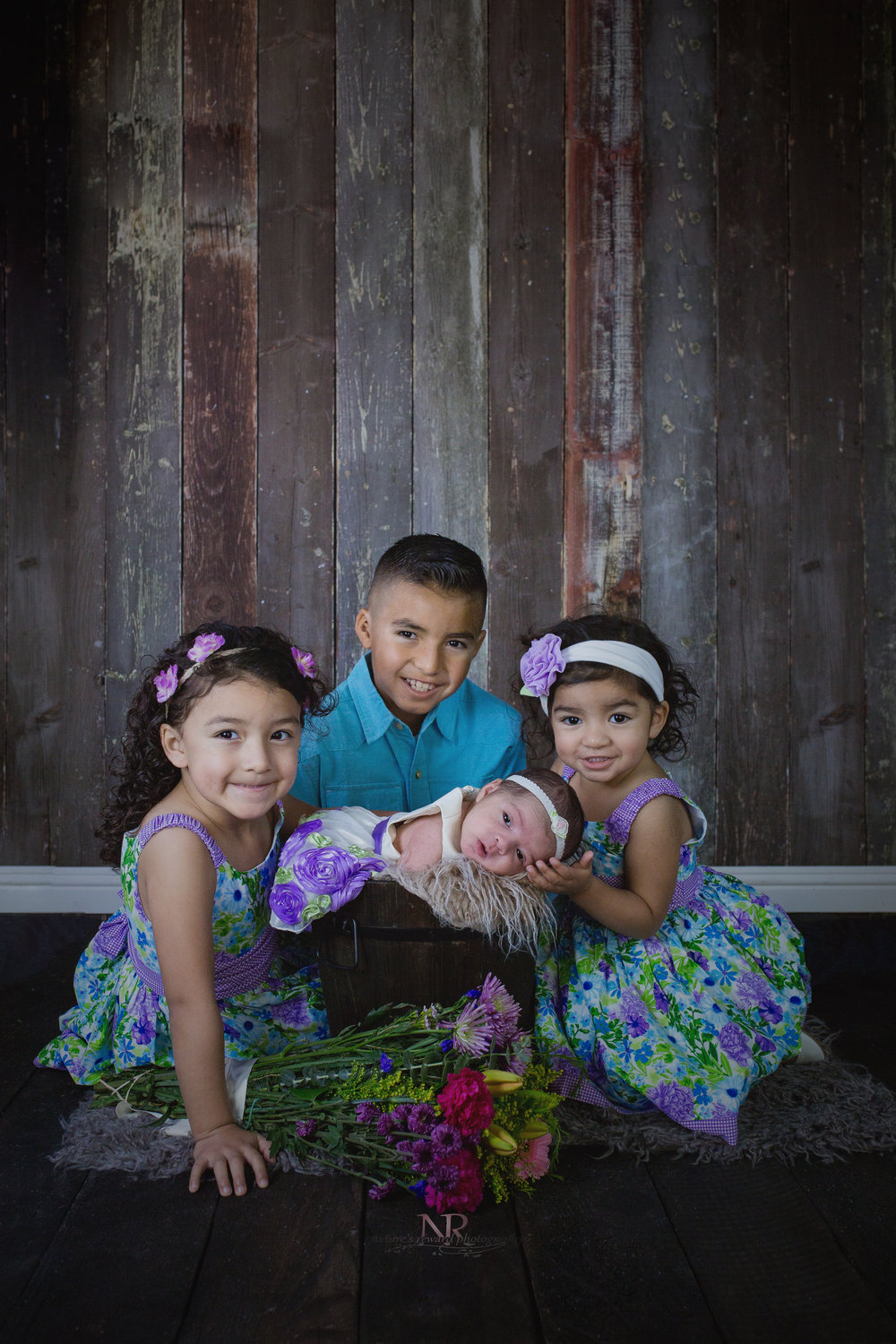 One image and all the kids. The real struggle in an image like this is actually the 2-3 year old siblings.  They need to have their pictures done immediately as they will not last long.